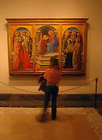 A woman looks at paintings in the Vatican Museum in Rome, Italy March 2, 2006. (Photo by Alan Greth)