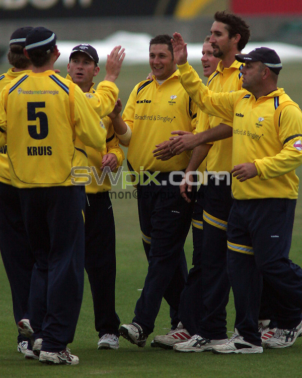 PICTURE BY VAUGHN RIDLEY/SWPIX.COM -  Cricket - Twenty20 Cup - Durham v Yorkshire - Riverside, Chester-le-Street, England - 03/07/06...? Simon Wilkinson - 07811 267706...Yorkshire's Tim Bresnan (C) is congratulated by his team-mates after getting Durham's Gary Pratt out for 12.