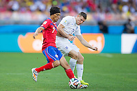James Milner of England and Christian Bolanos of Costa Rica