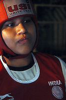 INDIA (West Bengal - Calcutta)August 2007, Shakila Babe waiting outside the ring during a championship  in Kolkata. Shakila and Shanno are twins from a poor muslim family of Iqbalpur, Kolkata. . Inspite of their late father's unwillingness to send his daughters to take up  boxing her mother Banno Begum inspired them to take up boxing at the age of 3. Their father was more concerned about the social stigma they have in their community regarding women coming into sports or doing anything which may show disrespect to the religious emotions of his community. Shakila now has been recognised as one of the best young woman boxers of the country after she won the  international championship at Turkey in the junior category. Shanno is also been called for the National camp this year. Presently Shakila and shanno has become the role model in the Iqbalpur area  and parents from muslim community of Iqbalpur have started showing interst in boxing. Iqbalpur is a poor muslim dominated area mostly covered with shanty town with all odds which comes along with poverty and lack of education. - Arindam Mukherjee