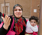 WOMAN READY TO FLEE THE CITY WITH HER CHILD, PLEADING FOR HELP FROM UK AND USA.  WHERE ARE THEY? SHE SAID.BENGHAZI..19-3-2011 PIC BY IAN MCILGORM
