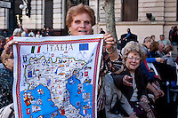 An immigrant resident shows a Italy map while she celebrates the day of the immigrant Calabres in Buenos Aires, Argentina, April 14, 2013 Photo by Juan Gabriel Lopera / VIEWpress.