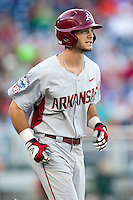 Arkansas Razorbacks outfielder Andrew Benintendi (16) jogs to first base after walking during the NCAA College baseball World Series against the Miami Hurricanes on June 15, 2015 at TD Ameritrade Park in Omaha, Nebraska. Miami beat Arkansas 4-3. (Andrew Woolley/Four Seam Images)