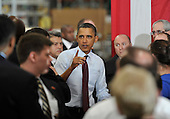 United States President Barack Obama greets workers and guests after making remarks at Orion Energy Systems, Inc. in Manitowoc, Wisconsin on Wednesday, January 26, 2011. President Obama, Vice President Joe Biden and other members of the President's Cabinet traveled across the country Wednesday to highlight the administration's efforts to rebuild the American economy.    .Credit: Brian Kersey / Pool via CNP