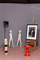atelier with easel and dress forms