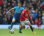 Alexis Sanchez of Manchester United tackled by Granit Xhaka of Arsenal during the premier league match at the Old Trafford Stadium, Manchester. Picture date 29th April 2018. Picture credit should read: Simon Bellis/Sportimage