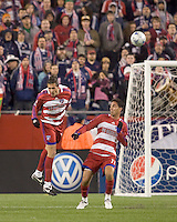 FC Dallas midfielder George John (14) heads the ball out as FC Dallas midfielder Andre Rocha (11) looks on. The New England Revolution defeated FC Dallas, 2-1, at Gillette Stadium on April 4, 2009. Photo by Andrew Katsampes /isiphotos.com