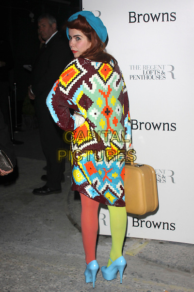 PALOMA FAITH .Attends the 40th anniversary celebrations of Browns fashion boutique, Marshall Street, London, England, UK, May 12th, 2010..arrivals full length dress hand on hip two tone tights platform patent shoes mary janes blue turquoise hat beret green yellow orange shiny patterned pattern sequined sequin brown v-neck oversized suitcase  back rear behind looking over shoulder side profile .CAP/AH.©Adam Houghton/Capital Pictures.