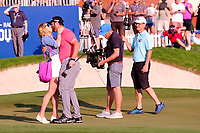 Jon Rahm (ESP) on the 18th green celebrating after winning  the DP World Tour Championship and race to Dubai with his fiance Kelly at the Jumeirah Golf Estates, Dubai, United Arab Emirates. 24/11/2019<br /> Picture: Golffile | Fran Caffrey<br /> <br /> <br /> All photo usage must carry mandatory copyright credit (© Golffile | Fran Caffrey)