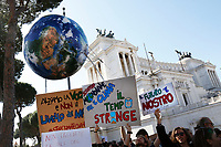 A huge globe and in the background the Altare della Patria<br /> Rome March 15th 2019. Colosseo e Piazza Venezia. Fridays for Future Climate Strike in Rome, to answer the call of Greta Thunberg, the Swedish 15 year old who is cutting class to fight the climate crisis.<br /> Foto Samantha Zucchi Insidefoto