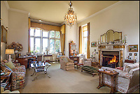 BNPS.co.uk (01202 558833)<br /> Pic: Strutt&amp;Parker/BNPS<br /> <br /> Be Lord of your own Manor...DIY skills essential.<br /> <br /> A grand country mansion that has been in the same family for 146 years is on the market - but you'll need deep pockets to become lord of this manor.<br /> <br /> The striking Grade II listed Victorian house, which sits beside an impressive lake and is surrounded by picturesque parkland, is being sold by Strutt &amp; Parker with a &pound;7.2million price tag.<br /> <br /> And while you get a lot for your money - with five cottages, outbuildings and 277 acres included in the sale - the main house is now in need of investment to restore it to glory and bring it up to date with all the mod cons expected in a home.