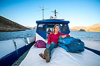 A woman on the ferry boat connecting Kalymnos with Telendos, while on a winter climbing trip in Greece.