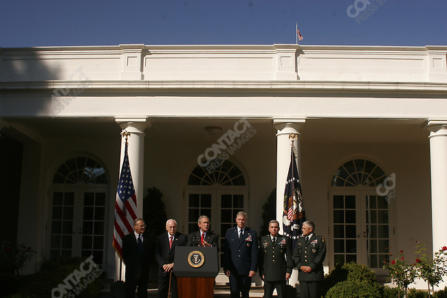 President George W. Bush makes a statement on the 'War on Terror' in the Rose Garden of the White House. Bush is pictured alongside (L-R) Secretary of Defense Donald Rumsfeld, Vice President Dick Cheney, Chairman of the Joint Chiefs of Staff General Richard Myers, Army General John Abizaid and Army General George Casey. Washington, D.C. September 28, 2005.