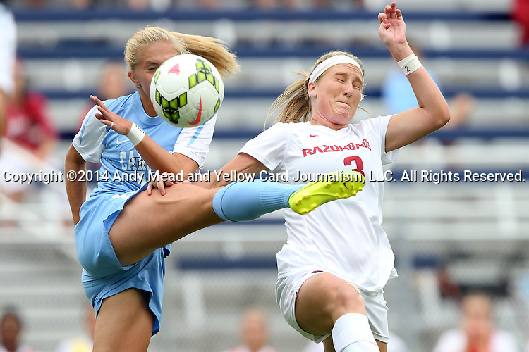 07 September 2014: North Carolina's Megan Buckingham (left) has a pass blocked by Arkansas' Hailey Pescatore (3). The University of North Carolina Tar Heels played the University of Arkansas Razorbacks at Koskinen Stadium in Durham, North Carolina in a 2014 NCAA Division I Women's Soccer match. UNC won the game 2-1.