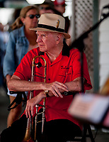 SARATOGA SPRINGS, NY - AUGUST 25: A man sits with his trombone on Travers Stakes Day at Saratoga Race Course on August 25, 2018 in Saratoga Springs, New York. (Photo by Carson Dennis/Eclipse Sportswire/Getty Images)