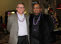 NWA Democrat-Gazette/CARIN SCHOPPMEYER  Boyd Evert (left) and Robel Lakwe, Havenwood board members, help welcome guests to the Mardi Gras Masquerade benefit Feb. 23 at Four Points by Sheraton in Bentonville.