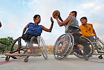 Bartolome Martinez (left) tries to block Manuel Rios from passing the basketball, as Roel Hernandez looks on, during practice in Zipolite, a town in Oaxaca, Mexico. The men are part of the Oaxaca Costa wheelchair basketball team.