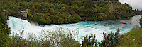 Panoramic Photo of Tourists on a Boat Tour at Huka Falls, Taupo, Waikato Region, North Island, New Zealand. The Huka Falls is an incredibly popular spot with tourists, just 4km outisde Taupo. The Waikato River narrows resulting in the thunderous Huka Falls, pouring over the final waterfall at 220,000 litres per second. A boat tour gives a great alternative view from the observation platforms that surround it.