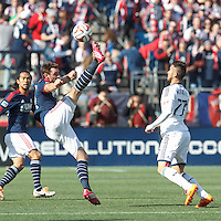 New England Revolution midfielder Andy Dorman (12). In a Major League Soccer (MLS) match, the New England Revolution (blue/white) tied Vancouver Whitecaps FC (white), 0-0, at Gillette Stadium on March 22, 2014.