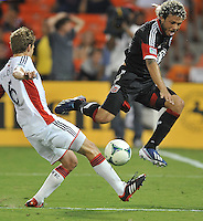 Nick De Leon (18) of D.C. United goes against Scott Caldwell (6) of the New England Revolution. The New England Revolution defeated D.C. Untied 2-1, at RFK Stadium, Saturday July 27 , 2013.