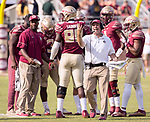 Florida State head coach Jimbo Fisher comes out of the huddle looking for the referee in the second half of an NCAA college football game in Tallahassee, Fla., Saturday, Nov. 4, 2017. Florida State defeated Syracuse 27-24. (AP Photo/Mark Wallheiser)