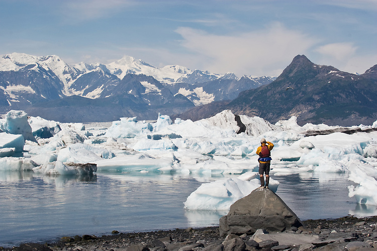 AAlaska, Prince William Sound, Lone sea kayaker standing on glacial erratic, Columbia Bay, Columbia Glacier, pack ice, USA, North America, David Fox, released,.