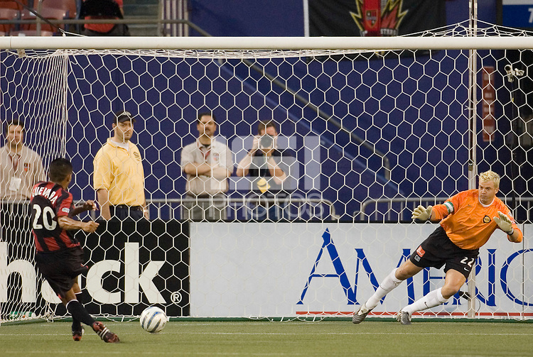 The MetroStars' Amado Guevara scores on a penalty kick in the 14th minute as goalkeeper Kevin Hartman guesses wrong during first half action between the MetroStars and the Los Angeles Galaxy at Giant's Stadium, East Rutherford, NJ, on July 9, 2005.