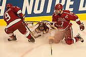 Luke Esposito (Harvard - 9), Willie Raskob (UMD - 15), Sean Malone (Harvard - 17) - The University of Minnesota Duluth Bulldogs defeated the Harvard University Crimson 2-1 in their Frozen Four semi-final on April 6, 2017, at the United Center in Chicago, Illinois.