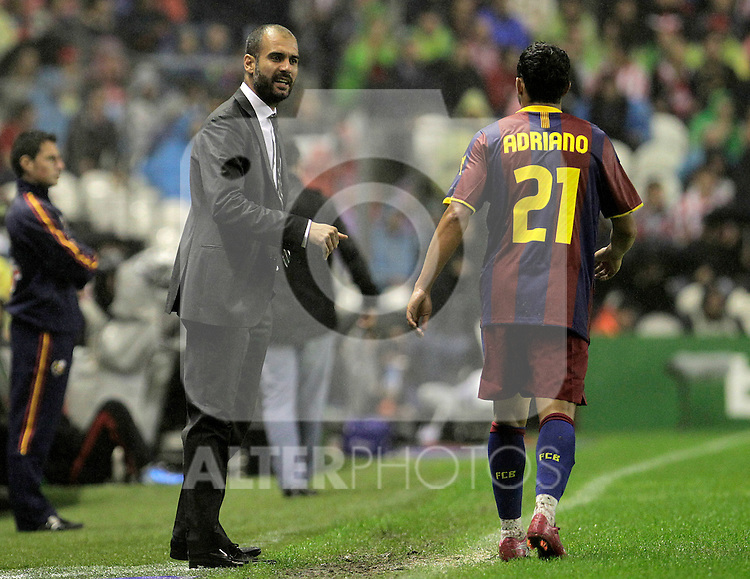 FC Barcelona's coach Pep Guardiola (l) and Adriano Correia during La Liga match.September 25,2010. (ALTERPHOTOS/Acero)