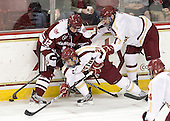 Rocco Carzo (UMass - 12), Steven Whitney (BC - 21), Tommy Cross (BC - 4) - The Boston College Eagles defeated the visiting University of Massachusetts-Amherst Minutemen 2-1 in the opening game of their 2012 Hockey East quarterfinal matchup on Friday, March 9, 2012, at Kelley Rink at Conte Forum in Chestnut Hill, Massachusetts.