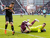17th March 2018, Tynecastle Park, Edinburgh, Scotland; Scottish Premier League football, Heart of Midlothian versus Partick Thistle;  Jon McLaughlan of Hearts   crashes into Aaron Hughes of Hearts