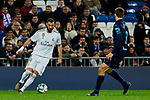 Karim Benzema of Real Madrid and Diego Llorente of Real Sociedad during La Liga match between Real Madrid and Real Sociedad at Santiago Bernabeu Stadium in Madrid, Spain. November 23, 2019. (ALTERPHOTOS/A. Perez Meca)