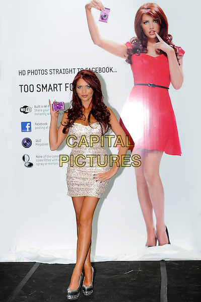 Amy Childs.launches Samsung's new range of SMART cameras at the at Westfield shopping centre in White City. London, England..May 1st, 2012.full length silver strapless dress sequins sequined hand on hip shoes.CAP/CJ.©Chris Joseph/Capital Pictures.