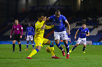 Oldham Athletic's Gevaro Nepomuceno and AFC Wimbledon's Adedeji Oshilaja in action during the Sky Bet League 1 match between Oldham Athletic and AFC Wimbledon at Boundary Park, Oldham, England on 21 November 2017. Photo by Juel Miah/PRiME Media Images