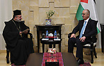 Palestinian Prime Minister, Rami Hamdallah, receives an invitation to attend the Midnight Mass for Christmas by the Eastern calendar, in the West Bank city of Ramallah, on December 31, 2018. Photo by Prime Minister Office