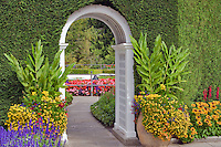 Pathway with flower and garden arch. Butchart Gardens, B.C. Canada