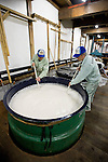 "Brewery workers perform ""kai-ire"" on sake moromi mix that will be ready to press in a few days at the Suehiro Sake Brewery in Aizu-wakamatsu City, Fukushima, Japan on 15 March 2013.  Photographer: Robert Gilhooly"