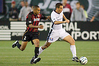 Ricardo Clark of the MetroStars chases Brian Kamler of the Revolution. The NY/NJ MetroStars were defeated by the New England Revolution 2-1 on 9/13/03 at Giant's Stadium, NJ..