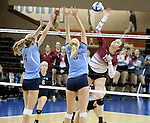 SIOUX FALLS, SD - DECEMBER 8:  Christine Carroll #13 from the University of South Carolina Aiken tries to get a kill past the defense of Emma Ballantyne #4 and Molly Burkhardt #3 from Palm Beach Atlantic during their quarterfinal match of the NCAA DII Volleyball Championships at the Sanford Pentagon in Sioux Falls, SD. (Photo by Dave Eggen/Inertia)