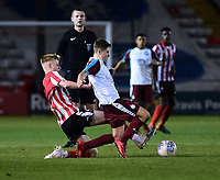 Lincoln City U18's Josh Woodcock vies for possession with  South Shieldsy U18's Ollie Scott<br /> <br /> Photographer Andrew Vaughan/CameraSport<br /> <br /> The FA Youth Cup Second Round - Lincoln City U18 v South Shields U18 - Tuesday 13th November 2018 - Sincil Bank - Lincoln<br />  <br /> World Copyright © 2018 CameraSport. All rights reserved. 43 Linden Ave. Countesthorpe. Leicester. England. LE8 5PG - Tel: +44 (0) 116 277 4147 - admin@camerasport.com - www.camerasport.com