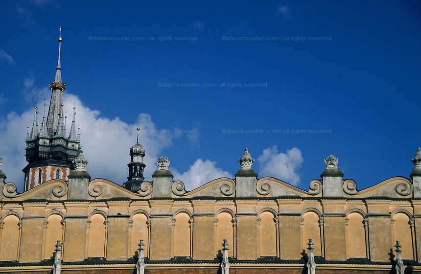 The spire Rynek Glówny (St Mary`s Basillica ) above the roof of the Cloth Hall in The Rynek in Krakow, Poland. July 1995