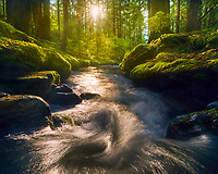 The setting sun illuminates a small cascade in the Mt. Hood wilderness, Oregon.