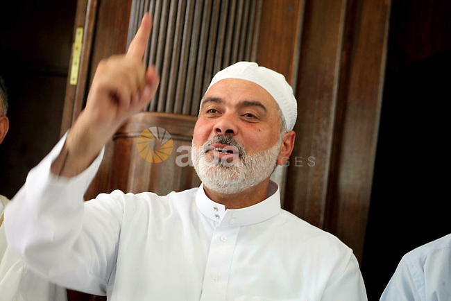 Palestinian Prime Minister in Gaza Ismail Haniyeh attends Friday prayer in Deir al-Balah in the center of Gaza Strip on 06 July 2012. A Palestinian official said Thursday, July 5, 2012 that Gaza's prime minister will head to Cairo within the next two weeks to meet with Egypt's new Islamist president, who has close ties with the territory's Hamas rulers. Photo by Ashraf Amra