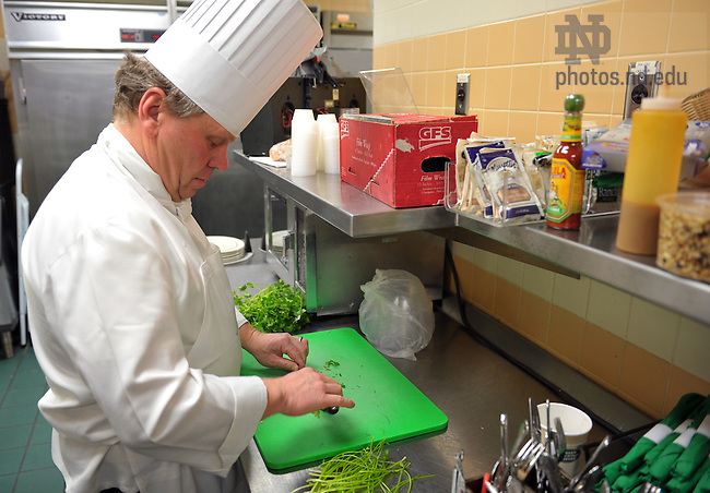 Jan.21, 2011; ND Food Services Executive Chef Donald Miller cuts herbs in the kitchen at Greenfields...Photo by Matt Cashore/University of Notre Dame