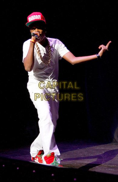 Young Marqus.Teen hip-hop sensation Young Marqus performed as part of the #1 Girl Tour with Mindless Behavior at the Fox Theater in downtown Atlanta, Atlanta, GA, USA, August 4th, 2012..music live on stage concert gig full length white t-shirt trousers red cap hat backwards trainers microphone singing hand .CAP/ADM/DH.©Dan Harr/AdMedia/Capital Pictures.