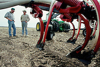 Wainwright, AB farmers, Mark Perkins, and Marc Rajotte (R) discuss plans for seeding on April 20, 2000.  JOHN ULAN/Epic Photography Inc.