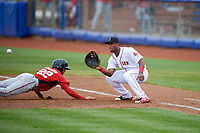Salem Red Sox first baseman Jerry Downs (30) waits to receive a pick off throw as Blake Perkins (22) dives back towards the base during the first game of a doubleheader against the Potomac Nationals on June 11, 2018 at Haley Toyota Field in Salem, Virginia.  Potomac defeated Salem 9-4.  (Mike Janes/Four Seam Images)