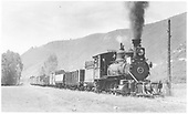 Engineer's-side 3/4 view of RGS 2-8-0 #40 with freight just north of Dolores.<br /> RGS  n. of Dolores, CO  Taken by Perry, Otto C. - 6/19/1942