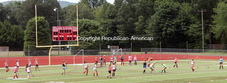 CHESHIRE- JULY 10 2014 070914DA11- Members of the Cheshire Field Hockey practice during day two of its camp at Cheshire High School on Wedesday.<br /> Darlene Douty Republican American