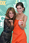 Actresses Shenae Grimes and Jessica Stroup arrive at the 2008 Teen Choice Awards at the Gibson Amphitheater on August 3, 2008 in Universal City, California.